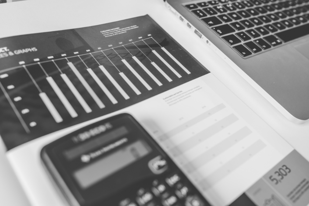 calculator, numbers, accounting, charts, graphs, finance, macbook, laptop, computer, technology, business, black and white, desk, money